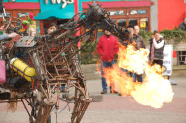 Mechanical fire breathing horse during the day