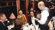 Hercule Poirot having dinner on the Orient Express