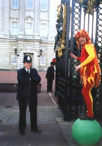 Andy Wood, on his walking globe, entertains a policeman.