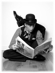 Contortionist Rubber Ritchie reads the paper!