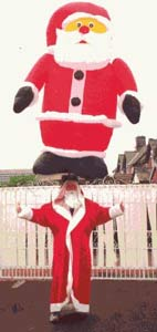 John Evans, Guinness Book of Records Headbalancer with Santa on his head.