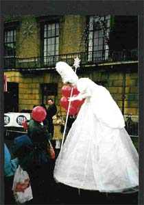Tamsin the stiltwalking Christmas Fairy chats to the public.
